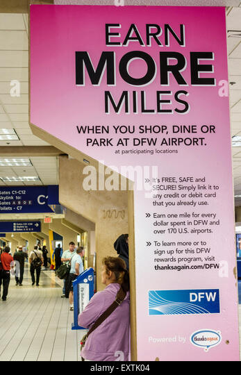 Dallas Texas Dallas Ft. Fort Worth International Airport DFW American Airlines terminal concourse sign ad promotion - Stock Image