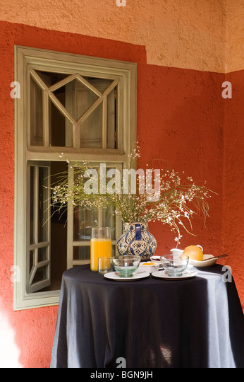 Breakfast table in a riad in the Medina of Marrakesh - Stock Image
