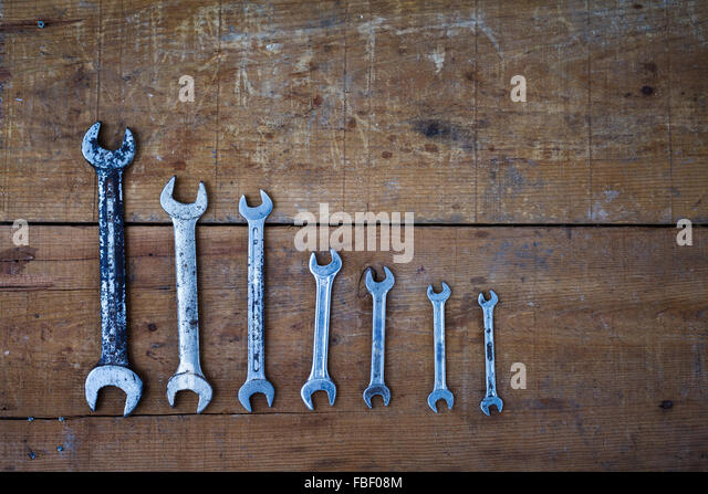 Directly Above Shot Of Various Wrenches On Wooden Table - Stock Image