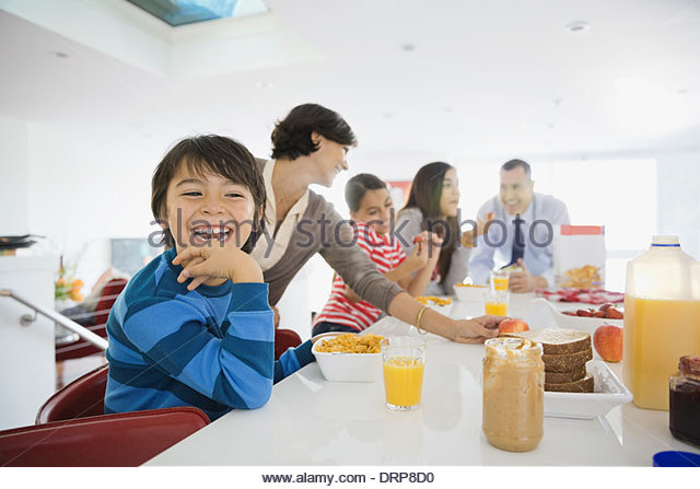 Family eating breakfast together - Stock Image