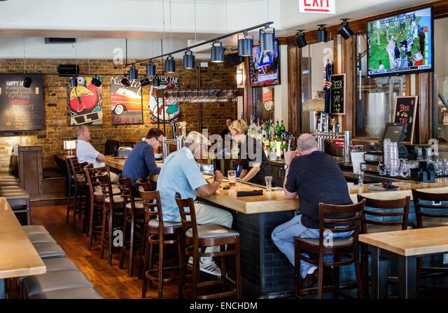 Chicago Illinois River North urban neighborhood Grand Avenue Rock Bottom Restaurant and Brewery restaurant dining - Stock Image