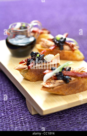 Tuna and Hot Pepper Toasts - Stock Image