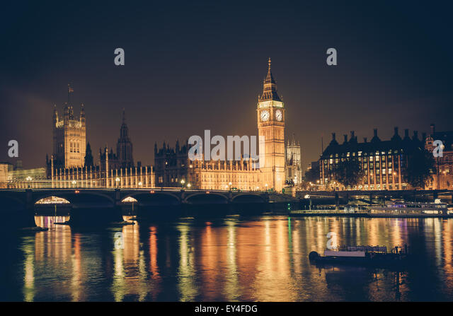 View of Big Ben and Westminster across Thames River at night.  This image has a retro filter effect - Stock Image