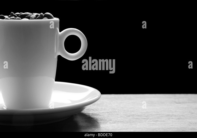 Coffee cup with coffee beans - Stock Image
