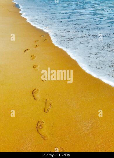 Tropical paradise. Sea, sun and sand. Summer vacation. Footstep on the sand - Stock-Bilder