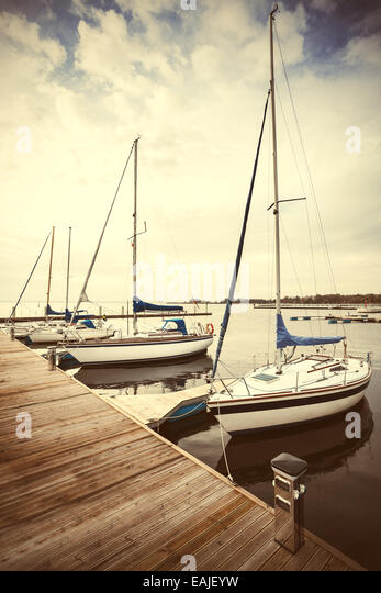 Retro filtered picture of yachts at pier. - Stock-Bilder