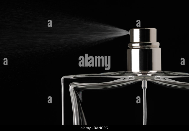 Perfume Spray Against a Black Background - Stock-Bilder