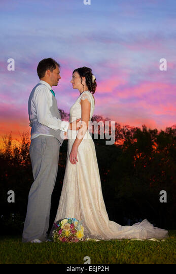 Newlyweds under a beautiful sky at sunset, South Africa - Stock Image