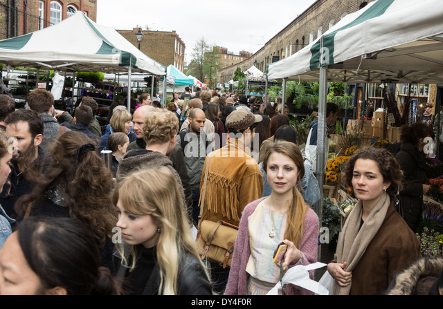 crowds at colombia road market London - Stock Image