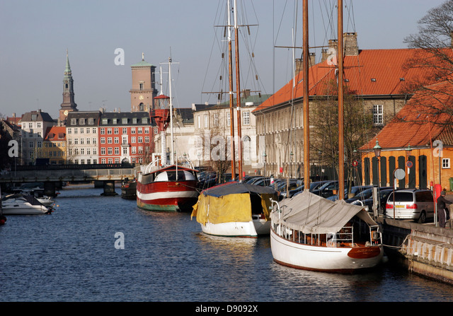 Frederiksholm canal with moored sailing boats, Copenhagen, Denmark - Stock Image
