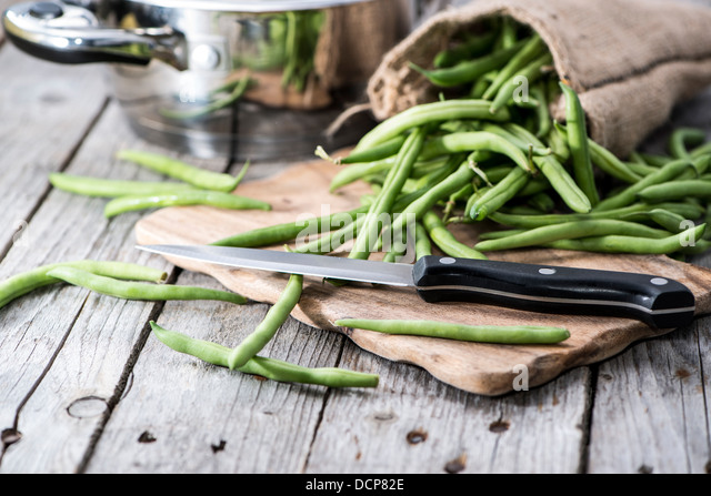 Green Beans on a grey vintage wooden background - Stock Image
