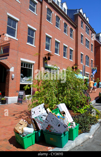 New Hampshire Portsmouth Bow Street businesses trash containers curbside curb sidewalk flattened cardboard boxes - Stock Image