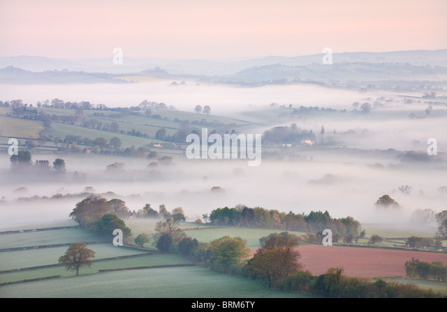 Mist covered countryside at dawn near Pennorth, Brecon Beacons National Park, Powys, Wales. Spring (May) 2010. - Stock-Bilder