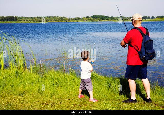 Wisconsin Kenosha Kansasville Richard Bong State Recreation Area Wolf Lake fishing father son man boy childhood - Stock Image