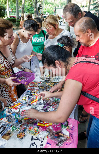Spain Europe Spanish Madrid Retiro Paseo del Prado street vendor accessories souvenirs - Stock Image
