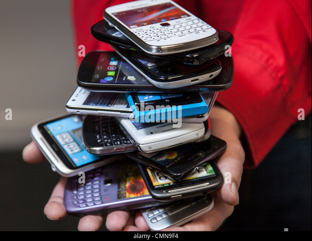Pile Of Cell Phones : Mobile phones pile stock photos
