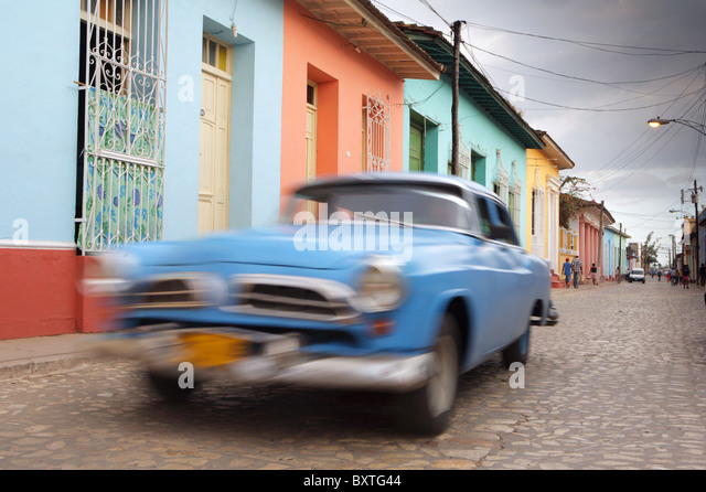 TRINIDAD: CLASSIC CAR ON COLOURFUL COLONIAL STREET - Stock Image