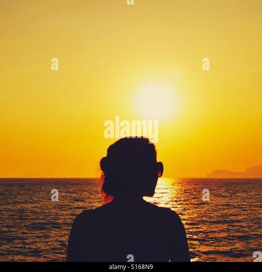 Silhoette at sea sunset - Stock-Bilder