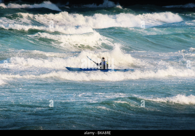 man canooing in the sea - Stock Image