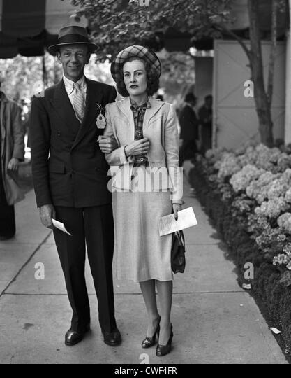 Fred Astaire, famed dancer, singer and actor, with wife Phyllis at Belmont Park, NY 1951 - Stock Image