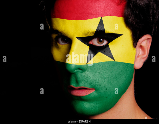 Flag of Ghana Painted on a Face of a Young Man - Stock Image