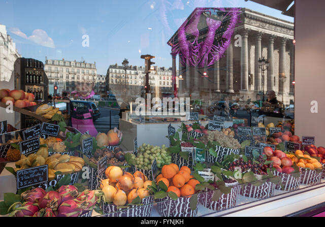 Paris France Place de la Madeleine Fauchon gourmet shop shop window reflection - Stock Image