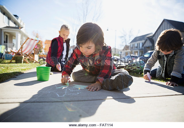 Kids drawing on sidewalk with chalk - Stock-Bilder