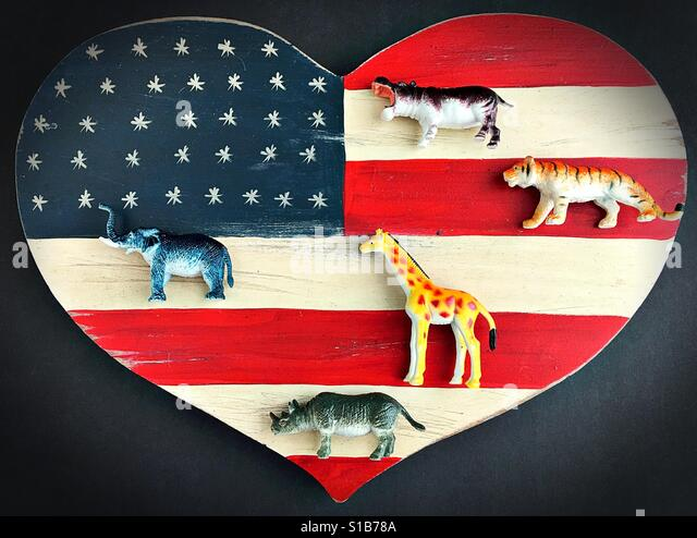 Wild exotic animals on a heart shaped American flag. - Stock Image