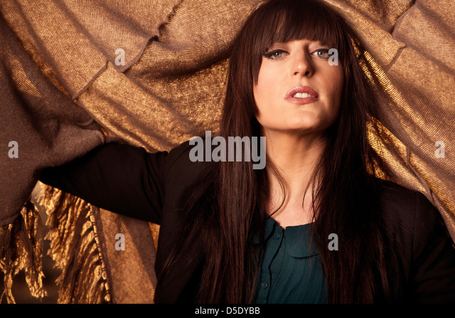 Woman with shaw and sunlight - Stock Image