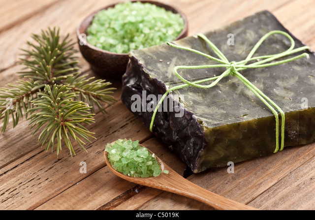 Pine soap with sea-salt and branch of pine. - Stock Image