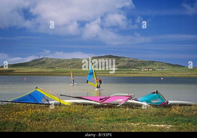Sail boarding on Loch Bhasapoll Isle of Tiree - Stock Image