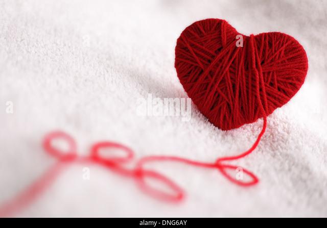 Yarn of wool in heart shape symbol - Stock-Bilder