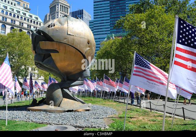 The Sphere by Fritz Koenig was damaged by the events of September 11, 2001 and now stands at Battery Park in New - Stock Image