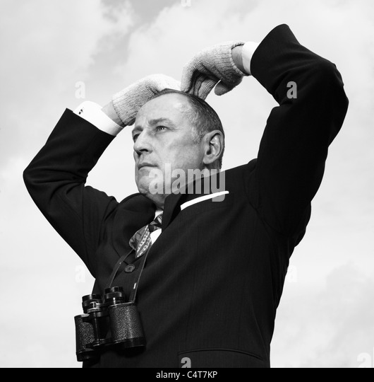 Old fashioned tic bookmaker or  tac man sending a message at the horse races. - Stock-Bilder