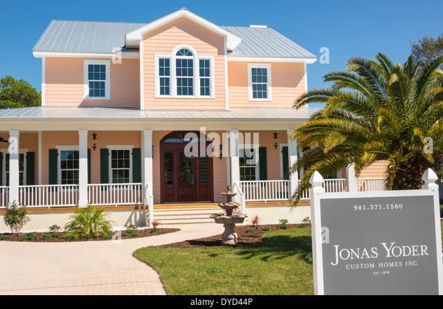 Sarasota Florida custom home new sale sign Jonas Yoder architect designer porch - Stock Image