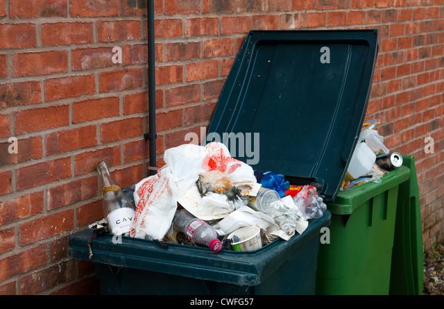 An overflowing rubbish bin, Shifnal, Shropshire, England - Stock Image
