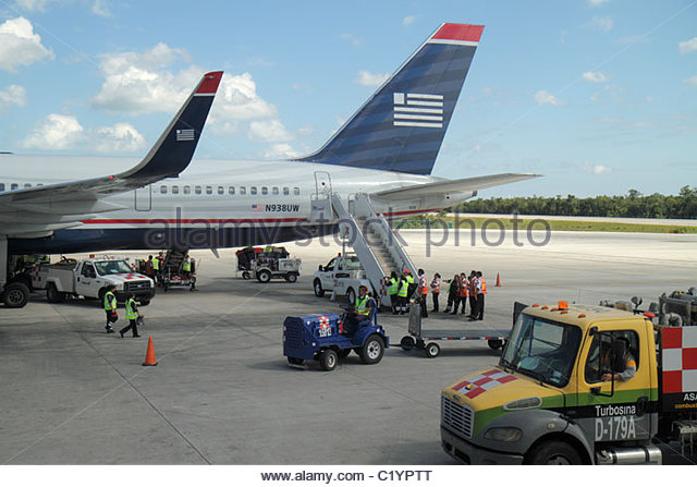 Mexico Yucatán Peninsula Cancun Cancun International Airport Quintana Roo gate area commercial airliner tarmac - Stock Image