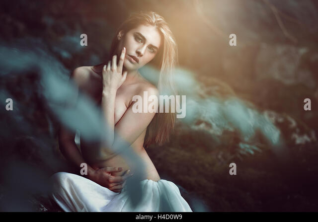 Beautiful daughter of the woods in soft dreamy light. Fantasy and magic - Stock-Bilder