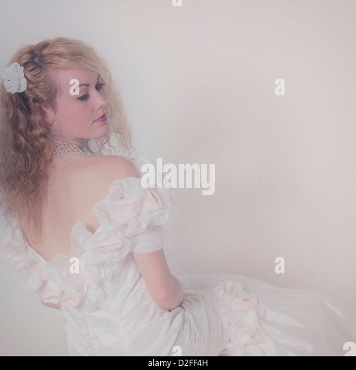 a beautiful woman in a romantic white dress - Stock-Bilder