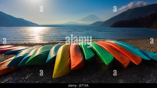 Group of colorful boat with fuji mountain at lake motosu japan - Stock Image
