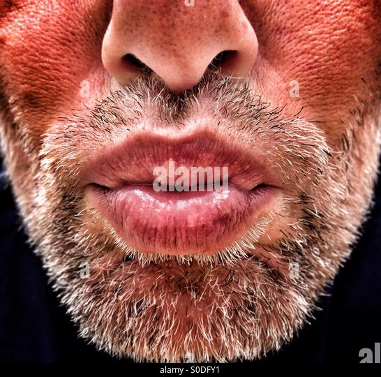 Adult male with beard blowing kiss - Stock-Bilder