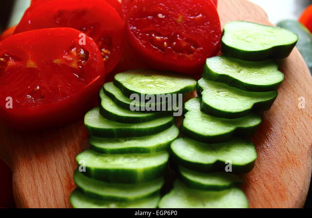 are sliced ??cucumbers and tomatoes ready to eat - Stock Image