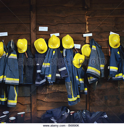 Firefighters clothes hanging - Stock Image