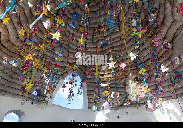 Christmas decorations made from household objects inside art installation outside Hayward Gallery, London - Stock Image