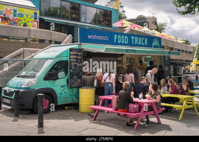 Tourists eating at a fast food eatery on the South Bank, London, England UK - Stock Image