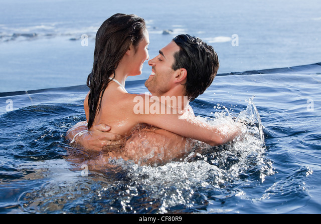 Joyful couple cuddling each other - Stock Image