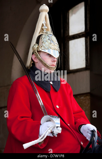 Mounted Household Cavalry guard outside entrance to Horseguards Parade, Whitehall, London, England, United Kingdom - Stock Image