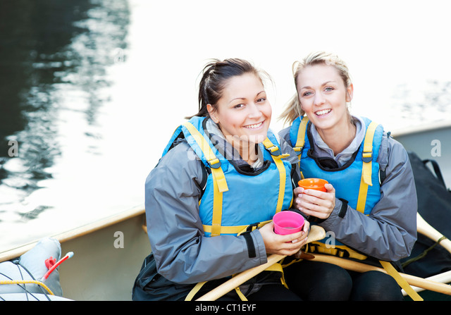 Women having coffee in canoe - Stock Image
