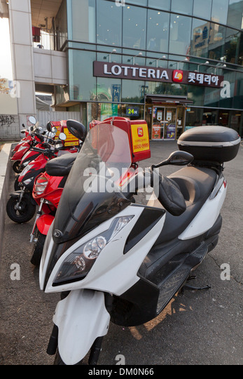 Lotteria fast food delivery scooters - Seoul, South Korea - Stock Image