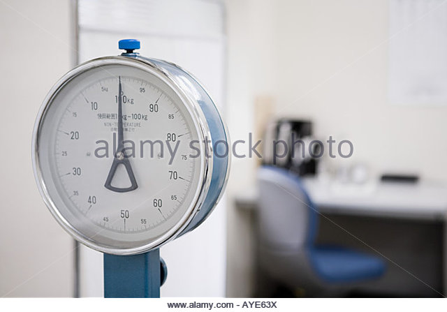 Scales in a doctors office - Stock Image